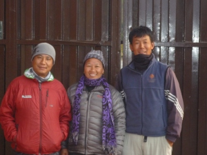 Mingmar (r), Doma (m) and IMG Guide (l) at the Kapan Monastery early after sunrise