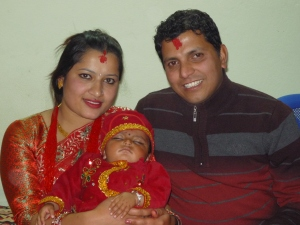 Proud parents & sleeping baby after a very long day of celebrating Pasni