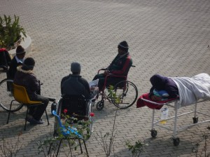 Patients catching the warmth of the sun