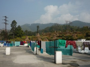 Family members of the patients to all the caring for the patients,including laundry, set out to dry on the roof.