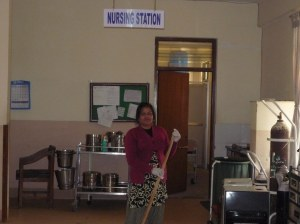 One of the cleaning staff at the nursing station