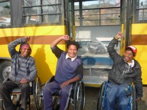 (l) Ramu (m) Dipak (r) Ram with smiling faces after loading the big sack of 19 bags on the bus for delivery to Sadle Traders, Bhaktapur.