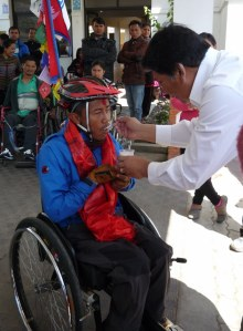 Prachanda Bdr. Shrestha, President of SISN, feeding Ram curd.  Curd is considered an auspicious food to serve to wish someone well,