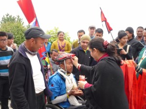 Tikka blessing from SIRC Executive Director Esha Thapa