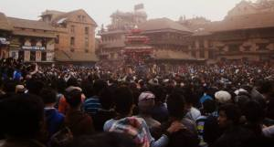 Crowds of people watching the chariot being pulled