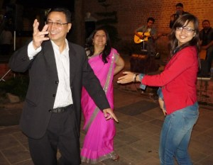Dr Anil, Esha and a guest getting the dancing going