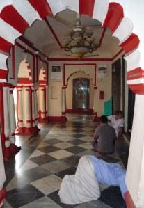 One man praying before the Goddess Durga