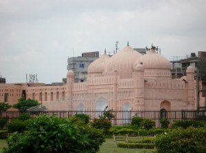 The attached mosque that is in use today.  The pink colour is because of the red earth surround the River Bhuriganga that is close by,