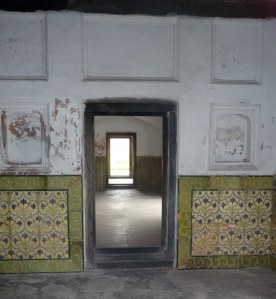 Each room of the fort backs onto another room with a view to the far side of the building.  Good to keep the inside cool.  Notice the beautiful painted tiles on the walls.