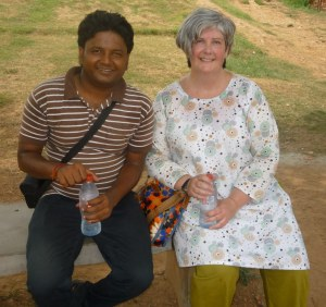 I had to sit in the shade for a while, it was so hot in the midday sun.  Here I am with Setu the guide.  And Happy is in my bag!