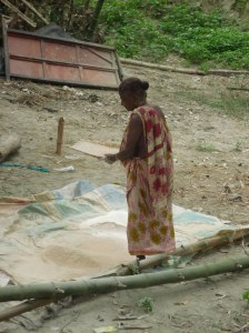Local lady sieving rice