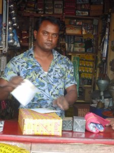 Progoti member running a mechanical parts store - a teeny tiny store in Shombhugonj!