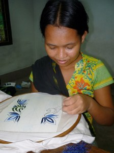 This is a young mum concentrating hard on the intricate design.