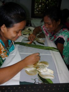 Two young ladies working on a fine embroidery piece together.  The giggling was infectious!
