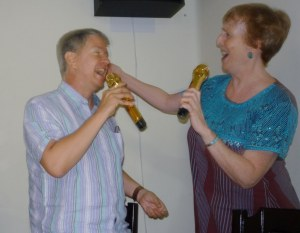 Sarah and Glenn belting out another tune, complete with gold plated microphones