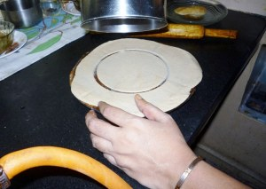 Making the perfect round for the puri before deep frying