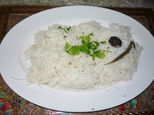 Rice flavoured with cumin seeds, bay leaf & black cardamon
