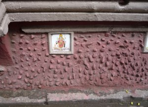 These are embedded into the side buildings about 2 feet from the ground .... to deter men from peeing on the side of the building - ughh!  It's hoped no man would want to pee on Ganesh.