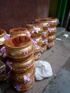 Baskets being lined up outside the sweets store.  They will be filled with sweets for a wedding later that day.