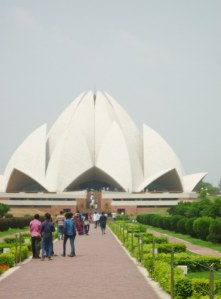 Getting a little closer to the Lotus temple as we walked along the path.  half way along shoes must be removed and that's when you see people dancing along the hot pavement.