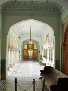 Arched hallway with a wood carved screen at the end to catch the breezes.