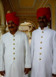 Two stately looking staff members to greet visitors to the City Palace compound.