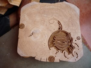 The intricate design of the block currently being carved by the master block carver at Anokhi Museum