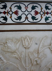 An idea of the detail on the Tajj Mahal's marble.  Below is one large piece of marble with the floral design carved in relief.  The upper part design is made by embedding precious and semi-precious stones onto the marble.  I thought it was painted on first, but it's inlaid - pretty spectacular!