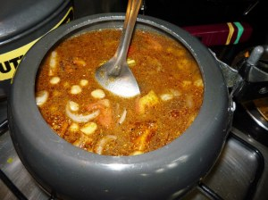 "Just before the Pindi Channa is boiled & then simmered until the chickpeas are ""mashable"" and the gravy/sauce thickens."
