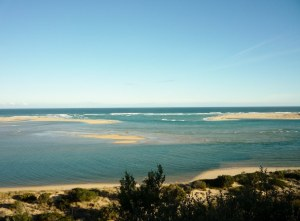 Lakes Entrance, where about 5 rivers flow into the Bass Strait.  Fresh water in the foreground, salt water beyond.