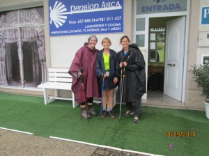 Finola, Grace and I drenched wet after a hard slog in pouring rain, arriving into O Pedrouso, knowing we were just 20km from Santiago de Compestella.