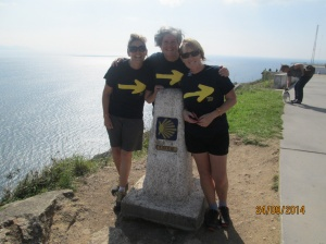 Us at the 0.0km Camino road sign, in our team t-shirts of course