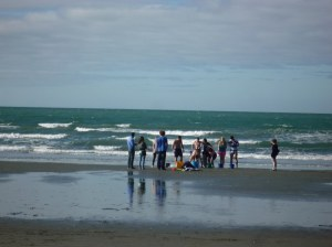 A bunch of young Irish folks, getting themselves ready for a mass ice bucket challenge.  they all ran into the sea afterwards - brr!