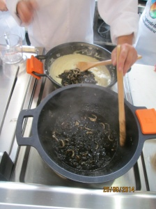 The two dishes used to make the Croquetas de Chipiron - sweated leek & onions and other seasonings, squid of course and a squid ink sauce.  In the far pot, a bechamel which will eventually be mixed with the squid, made into balls and deep fried to create the croquetas