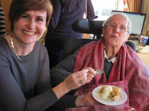 Sinead made mum's favourite - apple tart and cream.  Here is Sinead helping mum demolish the plate of tart!