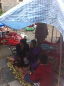 Giri Nabin, his wife, daughter and son in the makeshift shelter where they have spent the last two nights - in the wind & rain.  Giri is the manager of a hotel I stayed with for a night or two when I visited Kathmandu.
