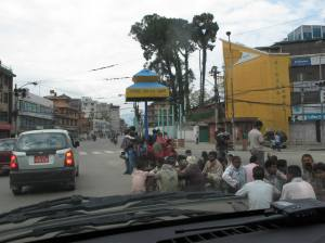 People in middle of road to escape aftershocks.  Photo Credit Kunda Dixit