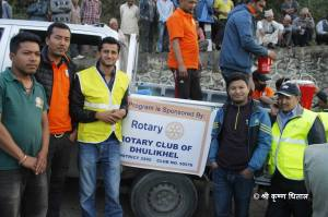 Shree (3rd left) with the Rotary sign