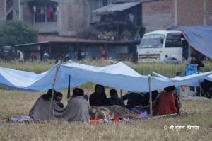 People taking shelter in an open field in Banepa
