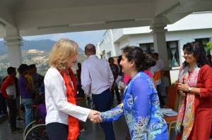 Joy Hutcheon, DfID Director General wishing good wishes to Esha Thapa, SIRC's Executive  Director.  To the right is Shanta Dixit,  co-founder of SIRC.