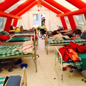 June 14 2015:  This tent is in full use as a hospital ward. The center has a capacity of 40 beds and is now at over 124 patients, (and counting). As of June 18th, 142 patients.
