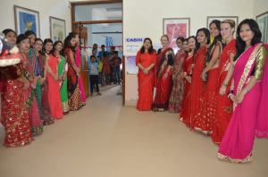 Lovely ladies dressed for Teej, lining up outside the Pediatric Cabin, just before the ribbon cutting.
