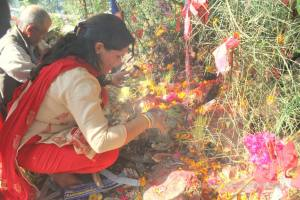 Angella, Shree's wife and mother to gorgeous baby Sanskriti, offers puja with her neighbours at Phoolbari village.