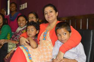 Esha pictured here with some patient's kids.  Photo credit SIRC
