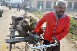 A happy Kathmandu resident with his stash of wood