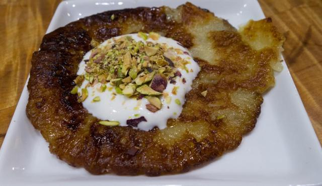 Malpua with curd and pistachios