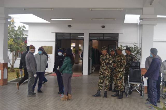 The reeiving team waiting for the injured to arrived. The Nepal Army were on hand to assist if needed.