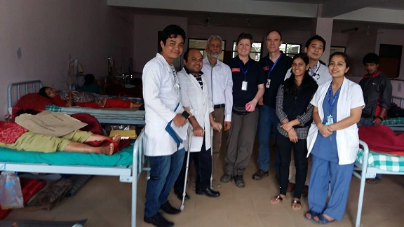 Prof. Dr. Taslim Uddin (Third from Left) during one of his daily medical rounds at the earthquake patient ward. © SIRC