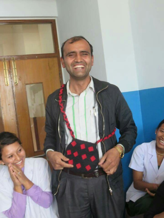 Nurse Bishnu Ghimire with his gift
