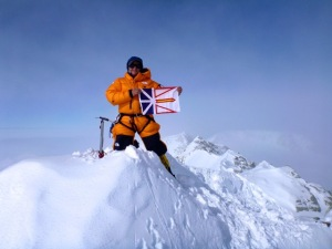 TA on the summit of Vinson Massif, Antarctic with the Newfoundland flag
